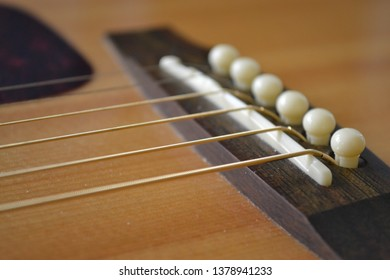 Close up of an acoustic guitar
