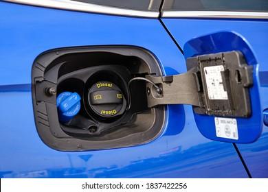 Close up Adblue Diesel exhaust fluid DEF and fuel tank cap, October 2020, Prague, Czech Republic