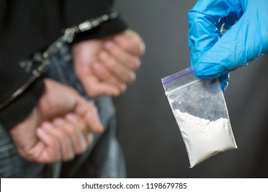 close up of addict narcotics dose cocaine. drug addict was arrested, police officer finds drugs during the search
