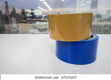 close up adhesive tapes on white table