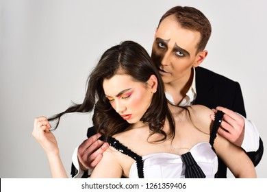 A close affective connection. Theatre actors miming through body motions. Sexy couple in love with mime makeup. Mime man hug woman with love emotions. Couple of mime artists perform romantic scene.