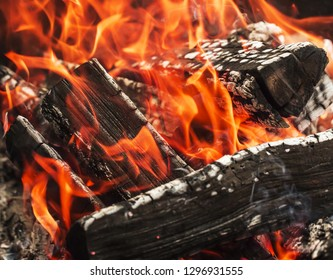 close up of the aflame wood in bonfire