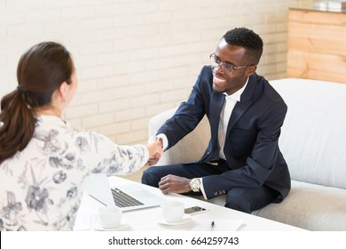 African american greeting stock images royalty free images close up of african american man shaking hand with his his female colleague in modern office m4hsunfo