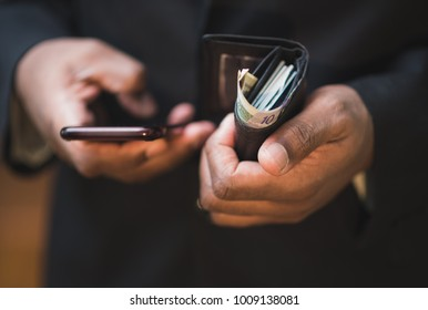 close up of african american man using mobile device