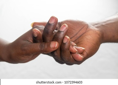 close up African American man and woman hand touching holding together isolated on white background for love and healing concept