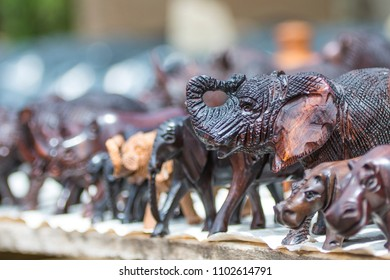 Close up of African Animals carved from wood in an open air market