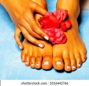 close up of african woman feet and hand holding flower, spa tan