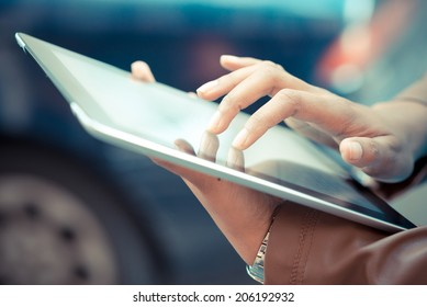 close up of african woman hands using tablet