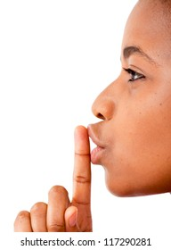 Close up of an African woman's finger on her mouth saying be quiet
