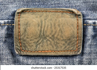 Close up aged blank leather patch on the back of a pair of jeans.