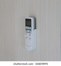 close up of Air conditioner remote on wallpeper