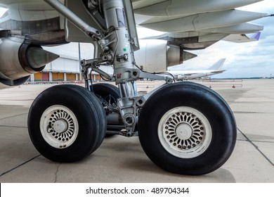close up of airplane wheel parked at the airport