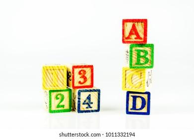 Close up alphabet blocks isolated on white background. Selective focus.