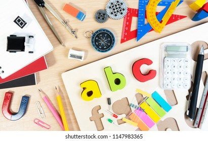 Close up of alphabet board game and basic equipment for elementary grade student for learning and playing. Wooden ABC alphabet game concept.