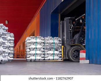 Close up aluminium ingot in bundle handling by forklift in warehouse.Moving aluminium ingot in bundle for stuffing.