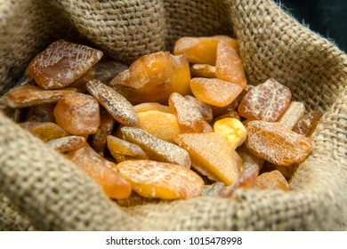 Close up of an amber stones in linen bag from Baltic sea