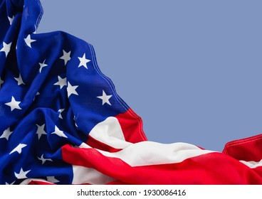 Close up of american flag on light blue background. united states of america patriotism concept digitally generated image.