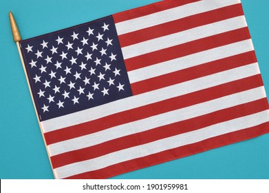 Close up of American Flag on turquoise background