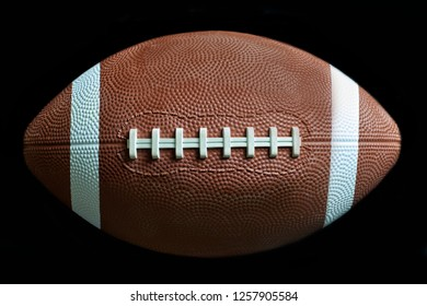 Close up of a American football on black background