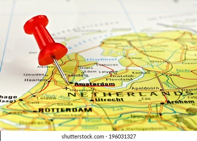 Close up of Amsterdam on a map with red pin