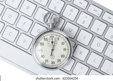 Close up of analog stopwatch on a white keyboard