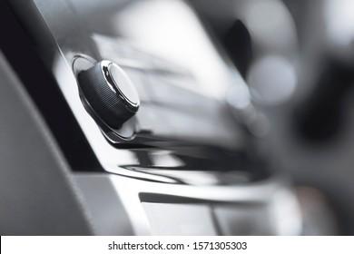 Close up of analogue volume control of car radio