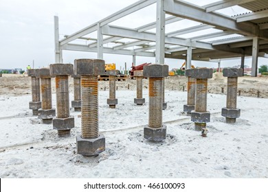 Close Up The Anchor Bolts In Concrete Base Of New Edifice With Reinforcement At Building Site