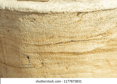 close up of Ancient Greek characters carved in stone