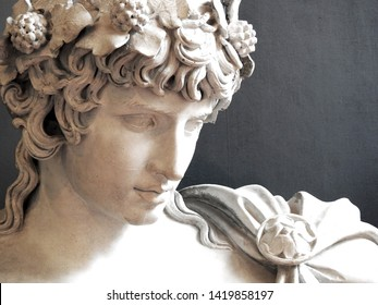 Close up of Ancient Greek Roman sculpture of Antinous dressed as god of wine Dionysus lover of Emperor Hadrian - Shutterstock ID 1419858197