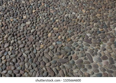 Close up of Ancient Stone Ground: Cobblestone Road in City Street in Italy.