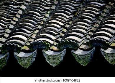 Close up of ancient traditional Chinese tiled temple roof with strong architectural detail