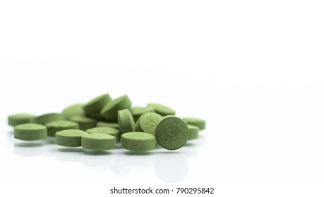 Close up Andrographis paniculata herbal medicine tablets pills. Antipyretic, relieve sore throat green alternative herbal medicine tablets on blur tablet background