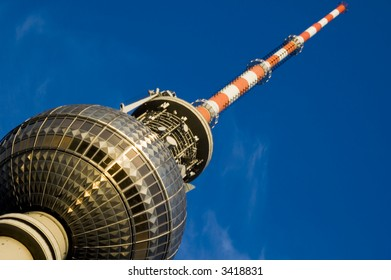 A close up angle on the TV tower Berlin shot on a summers evening just before the sun goes down