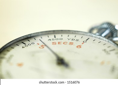 Close up angle view of antique naval stopwatch with shallow depth of field