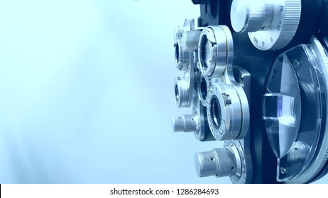 Close up angled view of phoropter on blue background
