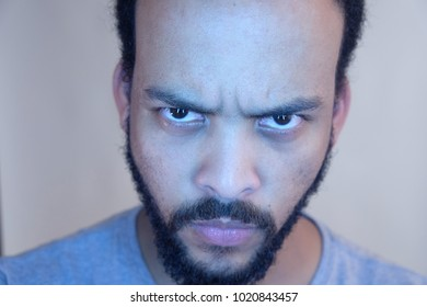 Close up angry face of bearded man