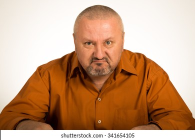 A close up of a angry man on white background