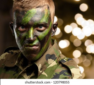 Close Up Of Angry Soldier against a background of shiny lights