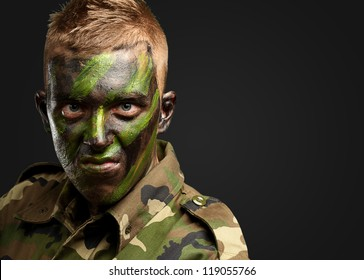 Close Up Of Angry Soldier against a black background