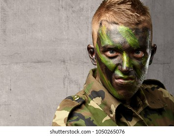 Close Up Of Angry Soldier against a concrete background
