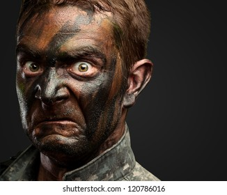 Close Up Of Angry Soldier Face against a black background