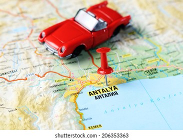 Close up of  Antalia,Turkey  map with red pin  and a car  - Travel concept