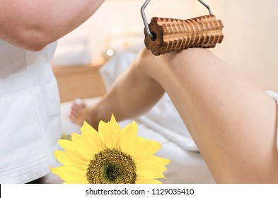 close up of anticellulite rolling pin leg massage in beauty spa salon