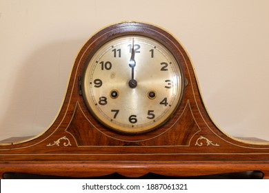 Close up of an antique clock showing 12 oclock