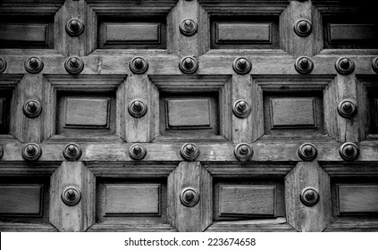 Close up of an Antique door allowing Access to an Ancient Church in Black and White