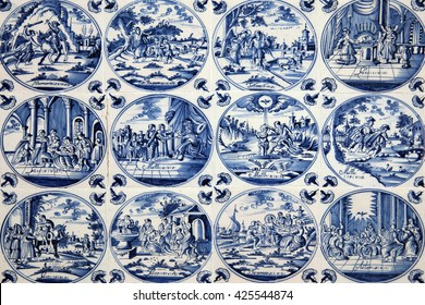 Close up of antique tin glazed blue Delft wall tiles dating from 1750-80, showing biblical scenes