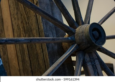 close up of antique vintage wood wagon wheel