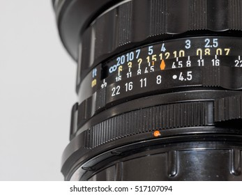 Close up of aperture ring of camera lens, selected focus on the number 8.
