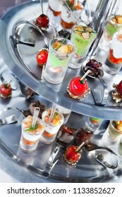 Close up of appetizers and glasses on a tray