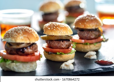 Close up of appetizing mini beef hamburgers on at catering event.